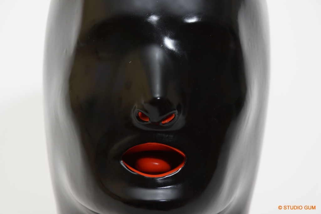 Apologise, but, A latex mask